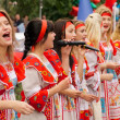 Girls in russian national dress sang — Stock Photo