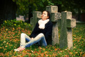 Sad girl sitting — Stock Photo