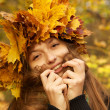 Girl in yellow leaves crown — Stock Photo #33736243