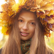 Girl in yellow leaves crown — Stock Photo #33736249