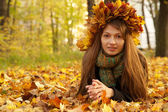 Girl in yellow leaves crown — Foto Stock