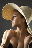 Girl in straw hat toned — Stock Photo
