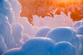 Fire and ice with icicles — Stock Photo