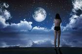 Girl in moonlight — Stock Photo