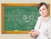 Girl near chalkboard — Stock Photo