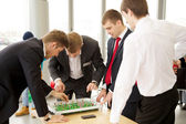 Men plays in football table game — Stockfoto