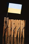 Clothespin team with flag of Ukraine — Stockfoto