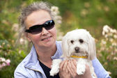 Mature woman holdiong her puppy — Stockfoto