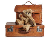 Well-Traveled Vintage Suitcase and Teddy Bear — Stock Photo