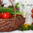 Raw vegetables in wicker basket — Stock Photo