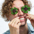 Smiling Young Men Covering her eyes with 4 leaf clover - Stock — Stock Photo #35615809