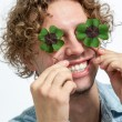 Smiling Young Men Covering her eyes with 4 leaf clover - Stock — Stock Photo