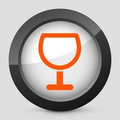 Vector illustration of a gray and orange icon depicting a glass — Stock Vector