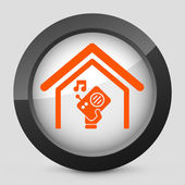 Vector illustration of a gray and orange icon depicting a radio on at home — Stock Vector