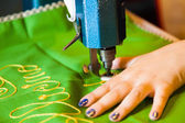 Lady hand at sewing — Stock Photo