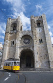 Lisbon cathedral and a tramway — Stock Photo