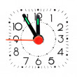 Photo: Clock showing five minute to midnight