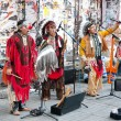 Stock Photo: Amerindians perform on street
