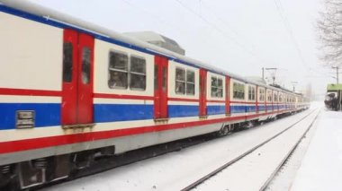 Electric train in snow — Stock Video