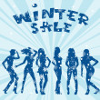 Winter sale advertising with women silhouettes — Stock Photo