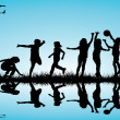 Group of children silhouettes playing outdoor — Stock Photo
