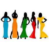Women wearing colorful long dresses — Stock Photo