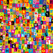 Seamless background with the letters of the alphabet — Stockfoto