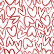 Stock Photo: Seamless pattern with doodle hearts