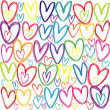 Seamless pattern with colored doodle hearts — Stock Photo #39337111
