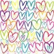 Stock Photo: Seamless pattern with colored doodle hearts
