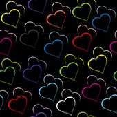 Black background with colored hearts — Stock Photo