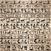Grunge background with Egyptian hieroglyphs — Stock Photo