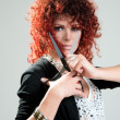 Beautiful red-haired girl with scissors - Foto Stock