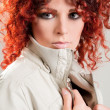 Beautiful red-haired girl in  jacket - Stock Photo