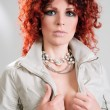 Beautiful red-haired girl in  jacket - Foto Stock