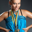 Beautiful girl with medals — Stock Photo