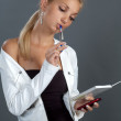 Blond girl with mobile — Stock Photo