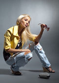 Blond girl in ragged jeans — Stock Photo