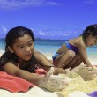 Polynesian sisters playing at the beach — Foto Stock