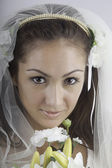 Young bride in veil with bouquet — Stock Photo