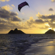 Kite boarding at daybreak — Stock Photo