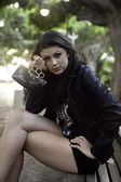 Teenage girl with brass knuckles — Stock Photo