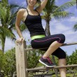 Young woman exercising -  