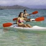 Couple paddling surfskis — Stock Photo #26057337