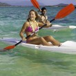 Stock Photo: Couple paddling surfskis