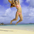 Pretty girl jumping at the beach — Stock Photo #26511461