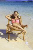 Girl in bikini on a beach chair — Stock Photo