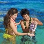 Island man shows seashells — Stock Photo #2862482