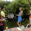 Friends having a barbecue party — Foto Stock