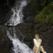 Blond woman in a waterfall — Foto de Stock